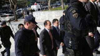 Turkish officers are escorted by Greek special police forces as they arrive at the Greek Supreme Court in Athens, for a hearing concerning a possible extradition of the officers over July's failed coup in Turkey, on January 23, 2017.   The case involves eight Turkish military officers who arrived in the northern Greek city of Alexandroupolis on the same helicopter in July 16, 2017, a day after a botched coup against Turkish President Recep Tayyip Erdogan. Since the coup, many Turkish military officers have requested asylum in other NATO countries. / AFP PHOTO / ANGELOS TZORTZINIS
