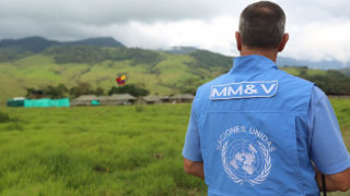 Handout picture released by the Gobernacion del Meta showing a UN representative, member of the Tripartite Mechanism for Monitoring and Verifying the Cessation of Fire and Bilateral and Definitive Hostilities and Detachment of Weapons, standing near one of the camps overseen by the UN that will receive FARC guerrillas before they lay down the arms as agreed in the peace accord signed with the Colombian government in November, in Mesetas, department of Meta, Colombia, on January 5, 2017. The UN is overseeing the FARC's disarmament as part of a peace deal the leftist guerrillas signed with the government to end a more than five-decade conflict. The FARC's 5,700 fighters are currently gathering near 26 zones where they are due to demobilize over a period of six months. / AFP PHOTO / Gobernacion del Meta / SEBASTIAN HERRERA /