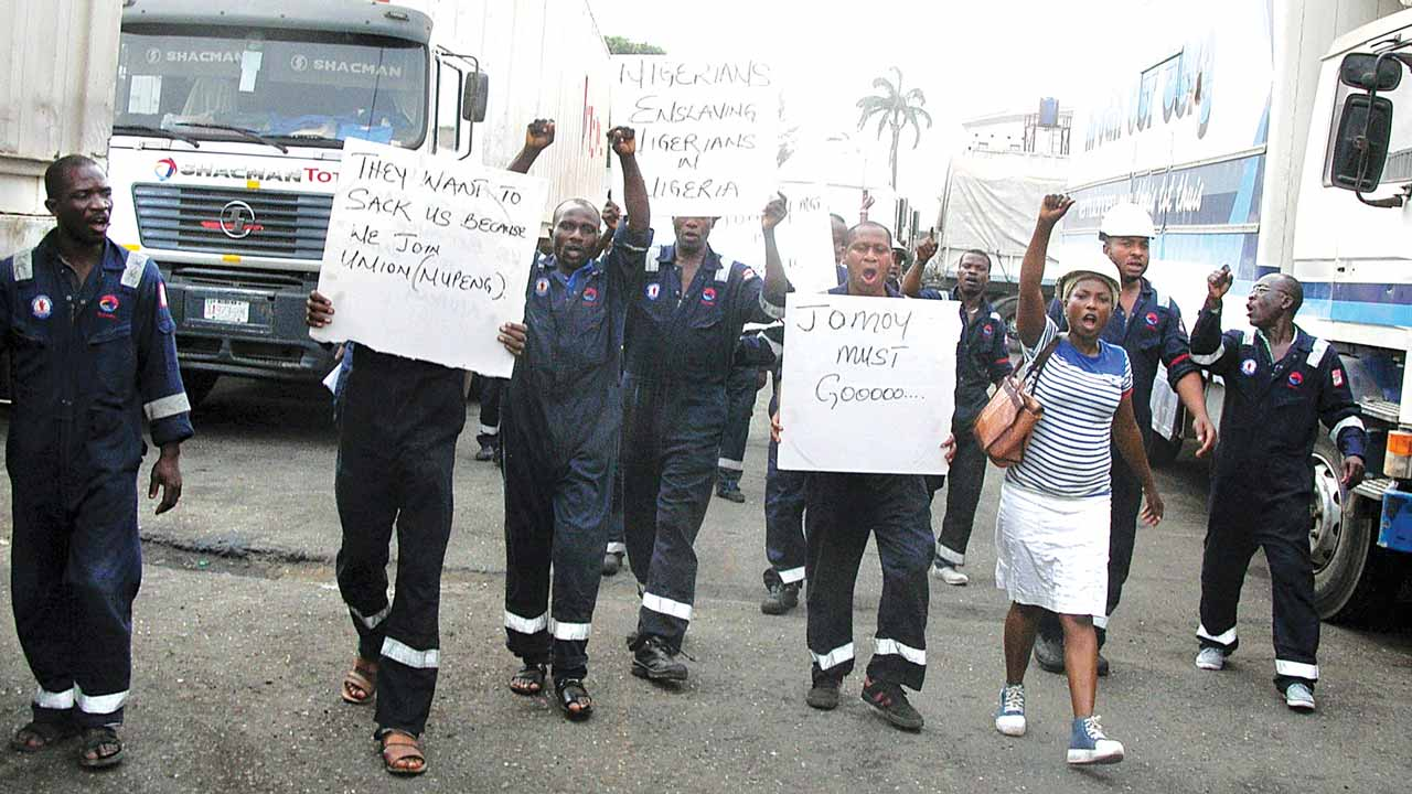 Members of the Nigeria Union of Petroleum and Natural Gas Workers (NUPENG), South-West Zone during the second day of their protest over alleged the anti-labour policies of Total Nigeria Plc. in Lagos…yesterday