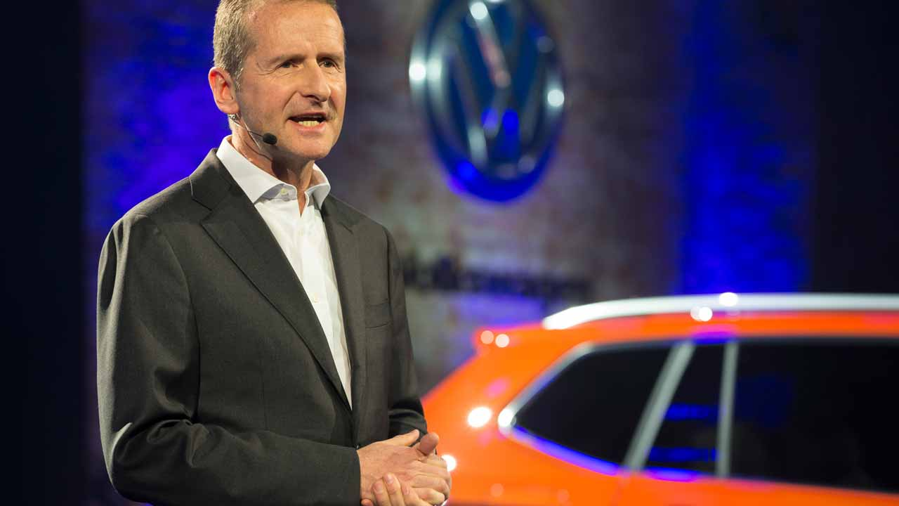 (FILES) This file photo taken on January 8, 2017 shows Volkswagen's Chairman of the Board Dr. Herbert Diess speaks during a press event on the eve of the 2017 North American International Auto Show in Detroit, Michigan, January 8, 2017. The head of the Volkswagen brand of cars said his company would continue to manufacture in Mexico and pledged to produce electrified vehicles in the United States.Herbert Diess, who took over Volkswagen AG's namesake brand in 2015, also said the company would produce electrified vehicles in the United States.Diess on January 8, 2017 said Volkswagen would keep its production facility in Puebla, Mexico, where it produces the Jetta and the Golf MK7. Geoff Robins / AFP