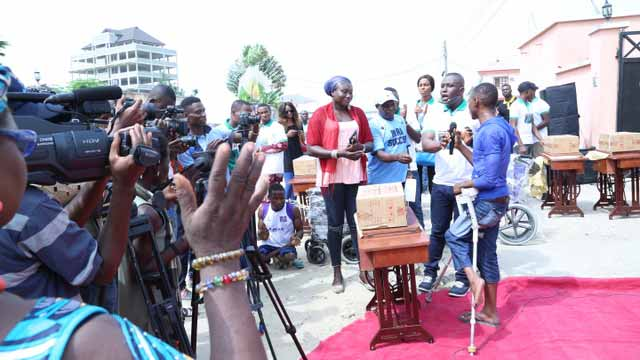 The MD/CEO of Livelihood Homes Ltd & Livelihood Farms  (owners of Blue Sea Estate Int), Dr. Kelly Nwogu (with microphone, second right) when he gave out lots of wheelchairs, sewing machines, clippers, electronic hair dryers among others as part of his  empowerment programme for the disabled in Lekki, Lagos at the weekend.