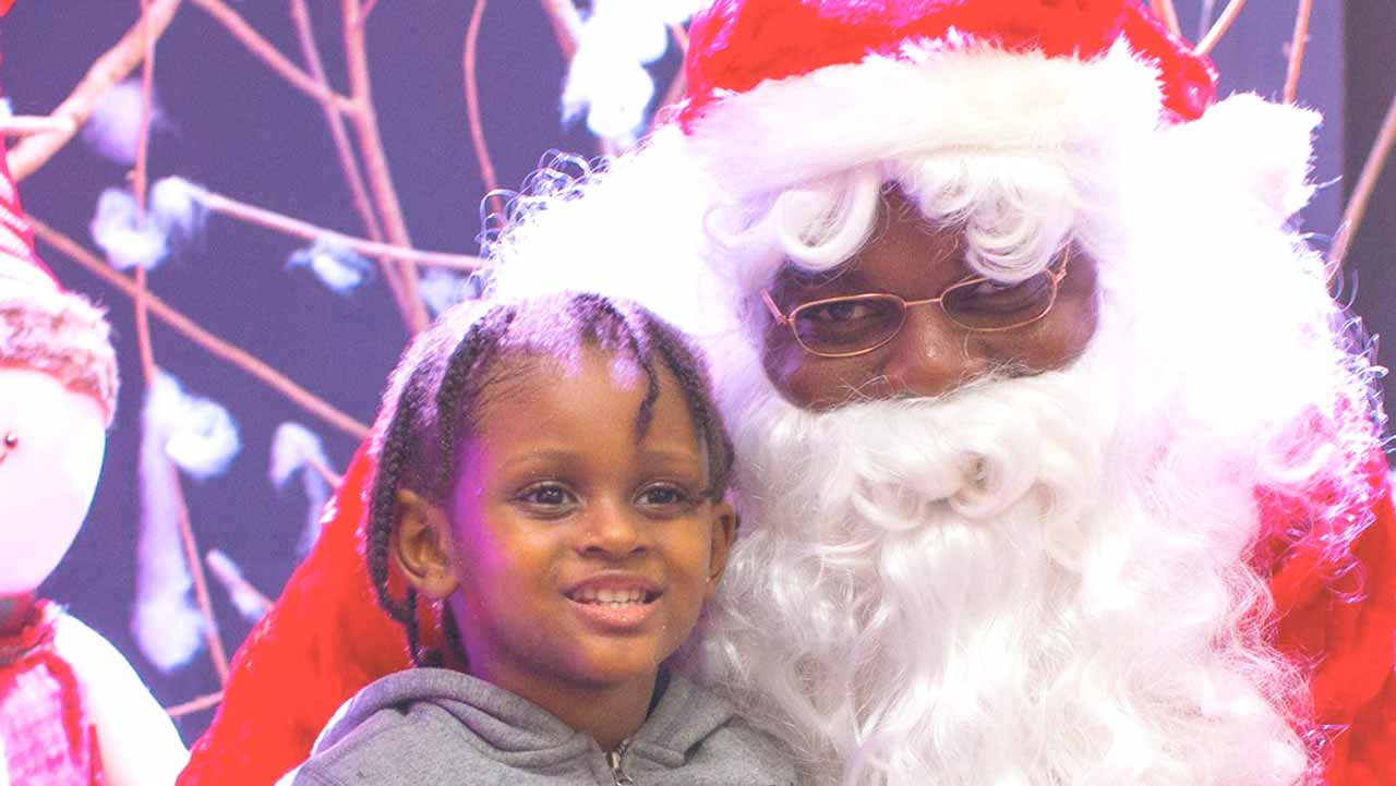 Santa with a child at the launch.
