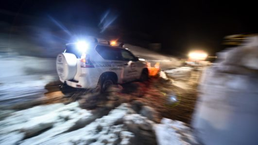 A volunteer from Ticino, Switzerland, clears the road with his own car snow plow in the village of Castelli, some 15 km from the site where an avalanche engulfed the mountain hotel Rigopiano in Farindola, near Penne, in earthquake-ravaged central Italy, on January 22, 2017. Rescuers combing the wreckage of the hotel in a bid to find survivors of a devastating avalanche detected no signs of life overnight, officials said on January 22. As the painstaking rescue operation entered a fourth day, firefighters and mountain rescue experts again had to battle extreme weather conditions as they tried to locate the 23 people thought to be trapped under a vast pile of snow and the mangled ruins of the Hotel Rigopiano. Nine people have been pulled alive from the rubble since rescuers first reached the remote hotel in the mountains of central Italy early on January 19. FILIPPO MONTEFORTE / AFP