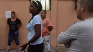Cuban migrants, who reached Panama in their attempt to get to the United States, socialize in the Pastoral Social Caritas Panama shelter in Panama City on January 12, 2017. US President Barack Obama on January 12, 2017 ended a decades old policy for Cuban immigrants, who will now face similar restrictions to other citizens from Latin America.  / AFP PHOTO / RODRIGO ARANGUA