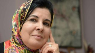 A photo taken on October 26, 2013 shows Moroccan doctor Asma Lamrabet posing at her home in Rabat. Lamrabet is used to multi-tasking -- mixing her writing with a career in medicine -- but perhaps her most noteworthy balancing act is being both a faithful Muslim and a committed feminist.  FADEL SENNA / AFP