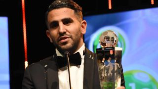 Algerian and Leicester forward Riyad Mahrez holds a trophy after being crowned African Footballer of the Year in Abuja, on January 5, 2017. Algerian and Leicester striker Riyad Mahrez has been crowned the CAF African best Footballer for 2016 and beating former best player and Gabonese forward Pierre-Emerick Aubameyang and Sehegalese striker Sadio Mane, for the continent's most prestigious individual award. PIUS UTOMI EKPEI / AFP