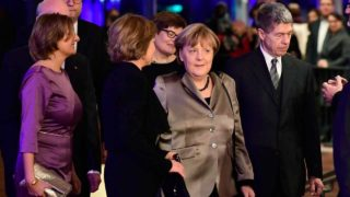 "German Chancellor Angela Merkel (c) and her husband Joachim Sauer arrive for a family photo prior to the opening of the Elbphilharmonie concert hall in Hamburg, northern Germany, on January 11, 2017. Around nine and a half years after laying the foundation stone, the new concert house nicknamed ""Elphi"" and sitting ontop of an old warehouse building will have its gala opening on January 11, 2017. Tobias SCHWARZ / AFP"