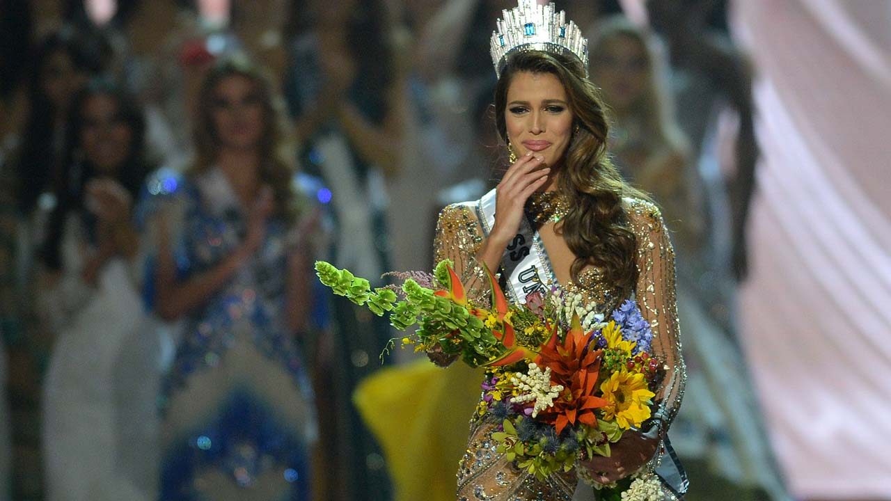 Iris Mittenaere (C) of France reacts after being crowned Miss Universe in the Miss Universe pageant at the Mall of Asia Arena in Manila on January 30, 2017. France was crowed Miss Universe on January 30 in a glitzy spectacle free of last year's dramatic mix-up but with a dash of political controversy as finalists touched on migration and other hot-button global issues. TED ALJIBE / AFP