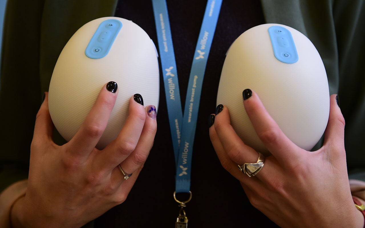 Anke Huiskes holds for display the Smart Breast Pump from Willow, two individual motorized cups for mothers to slip into their nursing bras and go about daily tasks instead of having to sit and wait, at the 2017 Consumer Electronic Show (CES) in Las Vegas, Nevada on January 8, 2017.    / AFP PHOTO / Frederic J. BROWN
