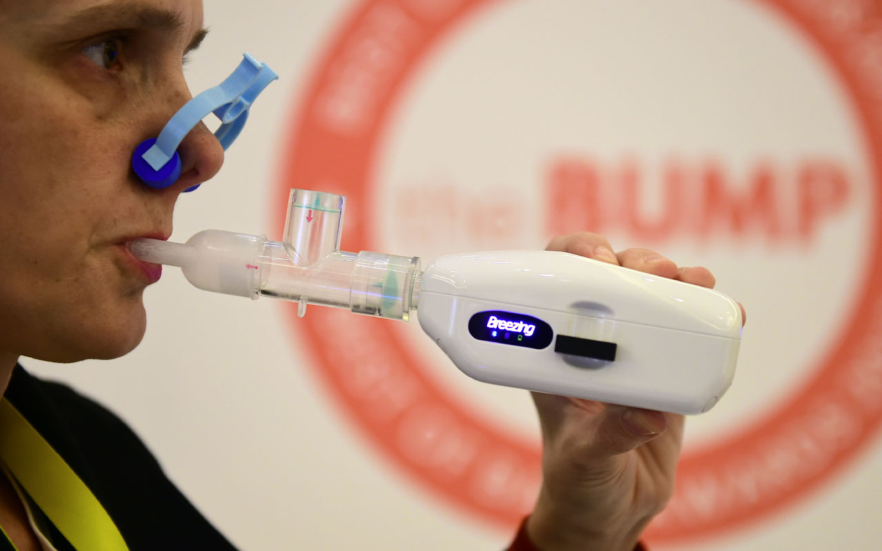 Erica Forzani gives a demonstration of Breezing, a device which measures one's metabolism and applying not only to pregnant women, at the 2017 Consumer Electronic Show (CES) in Las Vegas, Nevada on January 8, 2017.  / AFP PHOTO / Frederic J. BROWN
