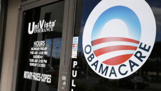 An Obamacare logo is shown on the door of the UniVista Insurance agency in Miami, Florida on January 10, 2017.  As President-elect Donald Trump's administration prepares to take over Washington, they have made it clear that overturning and replacing the Affordable Care Act is a priority. / AFP PHOTO / RHONA WISE