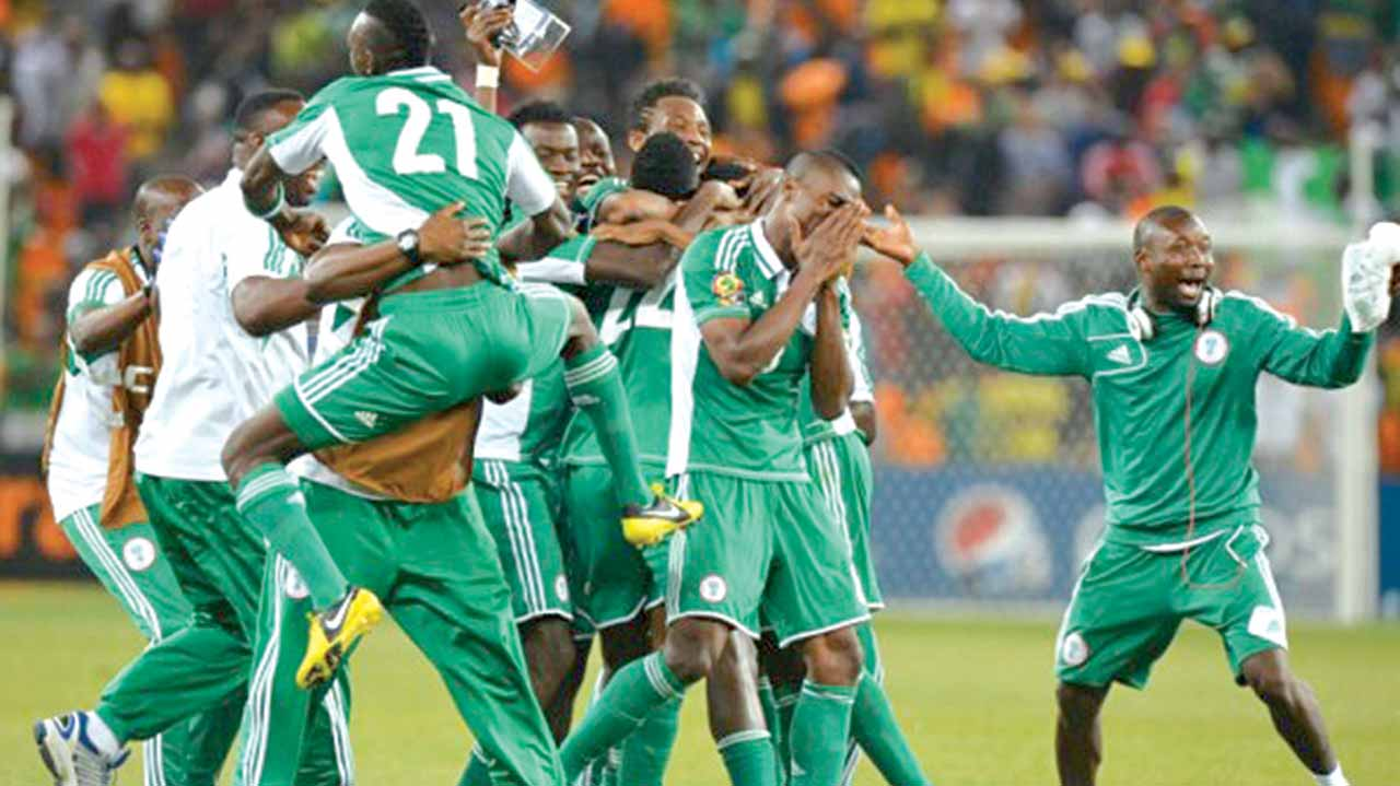 Super Eagles players celebrate victory in their 2018 World Cup qualifier in Uyo, Akwa Ibom State. Pinnick says FIFA's decision to expand the World Cup slots to 48 teams in 2016 will be of great benefit for Africa.