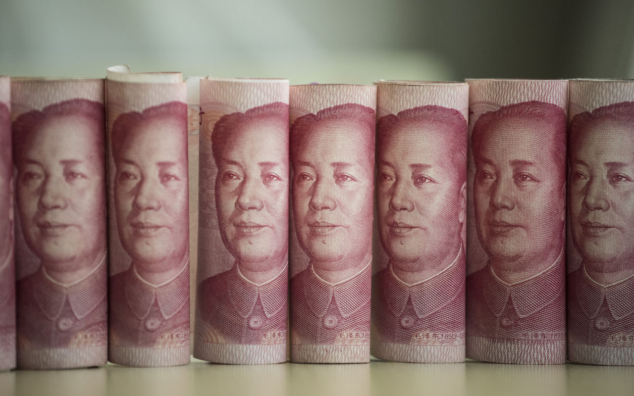 This photo illustration taken on January 6, 2017 shows Chinese 100 yuan notes in Beijing China just raised the exchange rate for the yuan against the US dollar by 0.92 percent from the previous day, the biggest one-day increase in more than 11 years. / AFP PHOTO / FRED DUFOUR
