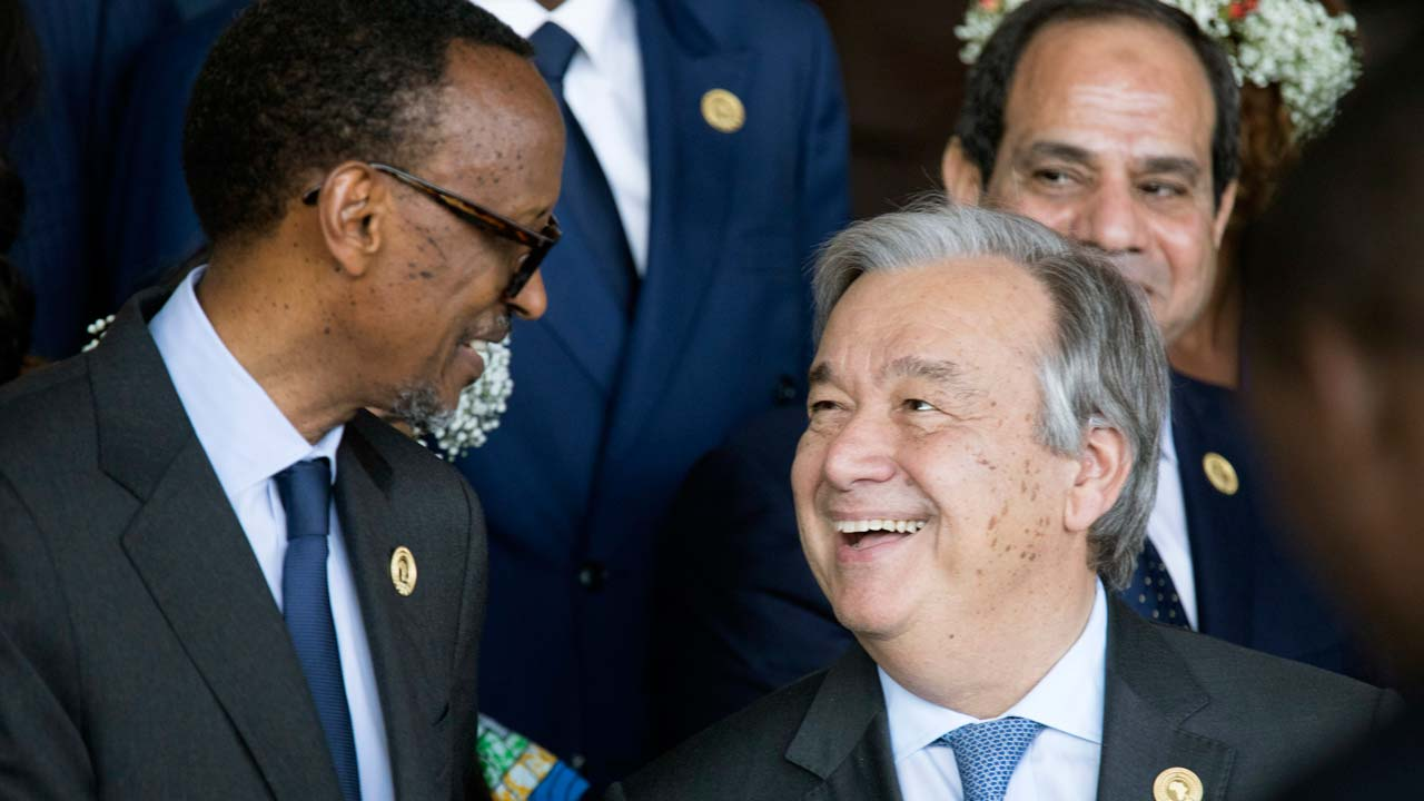 President of Rwanda Paul Kagame (L) speaks with Secretary General of the United Nations Antonio Guterres, as they gather for the family photograph during the 28th African Union summit in Addis Ababa on January 30, 2017. African Union leaders meet in Ethiopia on January 30 for a difficult summit likely to expose regional divisions as they debate whether to allow Morocco to rejoin the bloc, and vote for a new chairperson. ZACHARIAS ABUBEKER / AFP