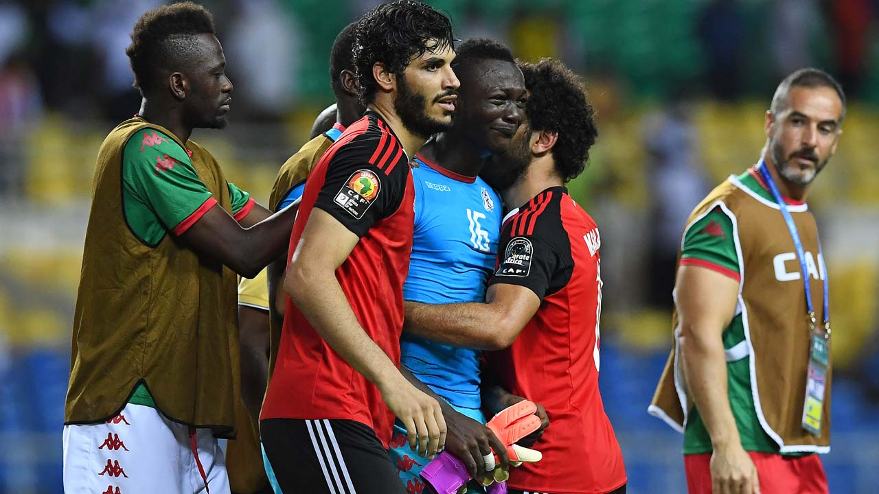 Burkina Faso's goalkeeper Herve Kouakou Koffi (C) is consoled as he cries at the end of the penalty shootout of the 2017 Africa Cup of Nations semi-final football match between Burkina Faso and Egypt at the Stade de l'Amitie Sino-Gabonaise in Libreville on February 1, 2017.  GABRIEL BOUYS / AFP