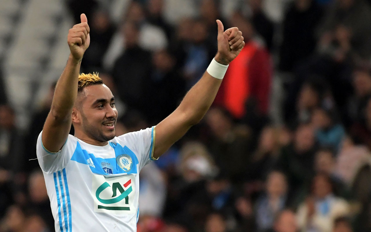 Olympique de Marseille's French forward Dimitri Payet celebrates at the end of the French Cup football match between Marseille and Lyon, on January 31, 2017 at the Velodrome stadium in Marseille, southern France. / AFP PHOTO / ANNE-CHRISTINE POUJOULAT