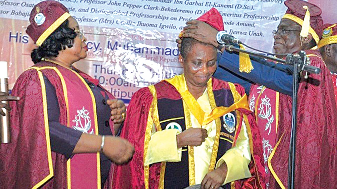 Vice Chancellor, University of Lagos, Prof. Rahamon Bello (right); West Africa's first female Professor of Pharmacy, Prof. (Mrs) Cecilia Ihuoma Igwilo and the Registrar and Secretary to Council, Dr (Mrs) Taiwo Ipaye during Prof. Igwilo's investiture as 'Distinguished Professor' by the University at the grand finale of the 2016 convocation of the institution.