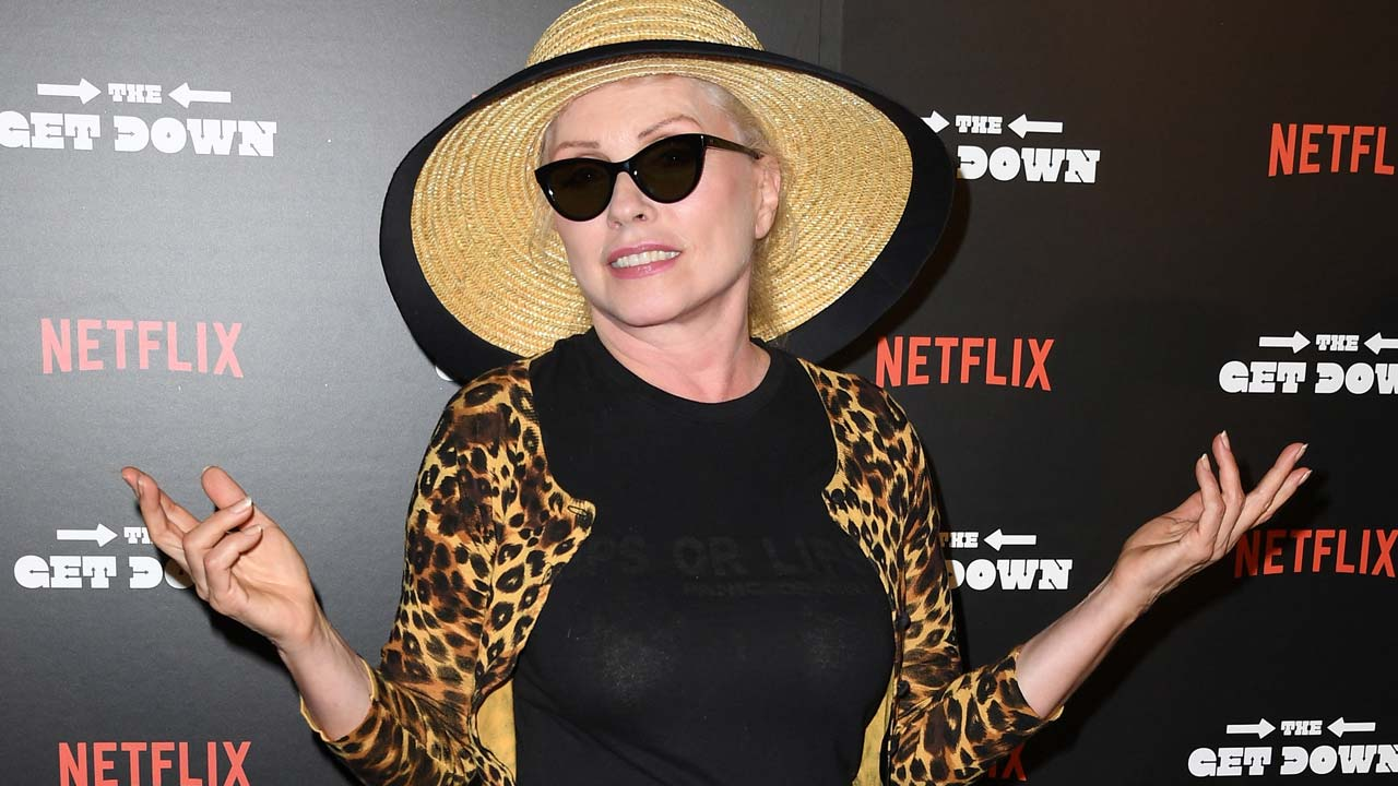"""(FILES) This file photo taken on August 11, 2016 shows singer Debbie Harry arrives for the premiere of """"The Get Down"""" at Lehman Center for the Performing Arts in Bronx, New York. New Wave pioneers Blondie on February 1, 2017 announced a new album that will bring in stars from across generations including Sia and Joan Jett. Entitled """"Pollinator,"""" the album will come out on May 5 and mark the first release in three years by the New York band fronted by 71-year-old Debbie Harry. The band released the album's first track, """"Fun,"""" which harks back to the disco era but with more contemporary electronic beats. ANGELA WEISS / AFP"""