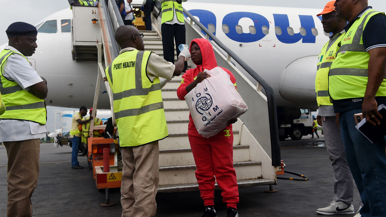 Nigerians stuck in Libya return home with a song