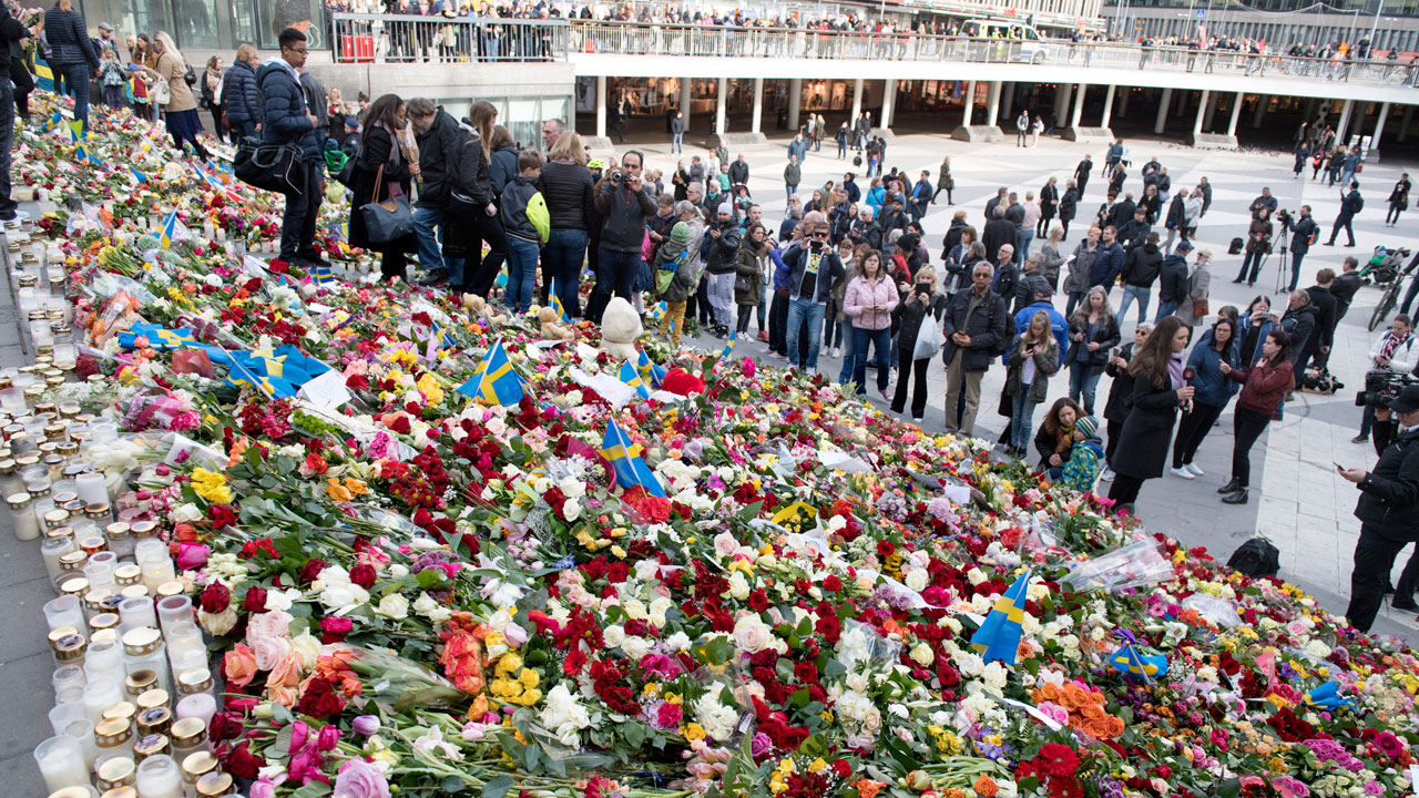 Image result for Truck attack: Residents keep vigil for victims in Stockholm